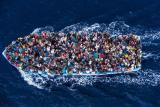 06-18-hcr-boat-refugees_1.jpg